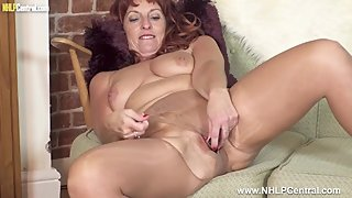 Mature busty sexpot Beau Diamonds masturbates dildo toy in ripped pantyhose
