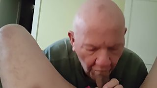 Bald grandpa on his knees sucking cock