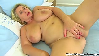 British milf Camilla Creampie gets busy with legs spread wide