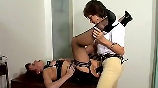 Lady Sonia fucks young PVC-clad Red XXX, 2004