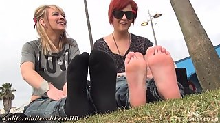 2 mature women remove fake uggs to show socks and feet