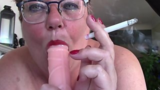 Big Nasty Red Lips Mature Plays with Dildo and Smokes