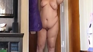 Ugly wife stands in the hallway nude showing her saggy belly and tits