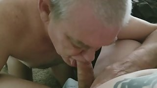 Good looking grandpa sucking cock & eating cum