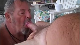 Daddy bear sucking another bear's dick