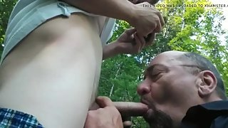 Older daddy sucking cock outdoors