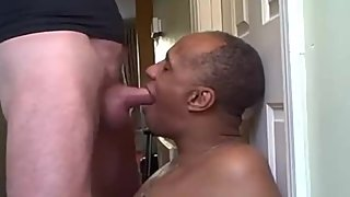 Black daddy giving an amazing blowjob to an older man