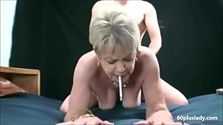 Short hair grandma smoking while is fucked doggystyle by young guy