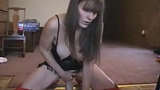 Webcam MILF records herself riding her dildo