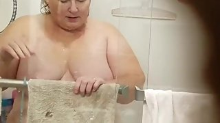 Ugly wife in the shower nude cleaning it