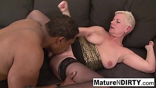 Blonde mature keeps her stockings on for fucking black cock!