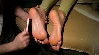 Aunt Anya's feet get massaged with cream and tickled