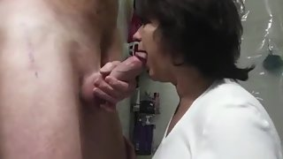 Horny mature stepmom gives her stepson nice blowjob