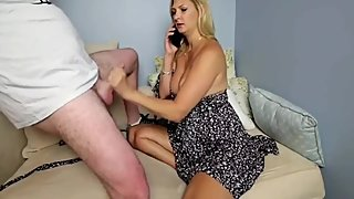 Cheating MILF jerking off her stepson's cock while phone talking to husband
